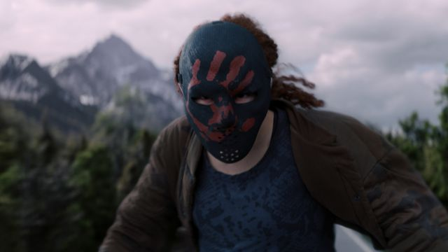 Erin Kellyman's Karli Morgenthau readies for a fight, wearing a black mask with a red handprint, in The Falcon and the Winter Soldier.