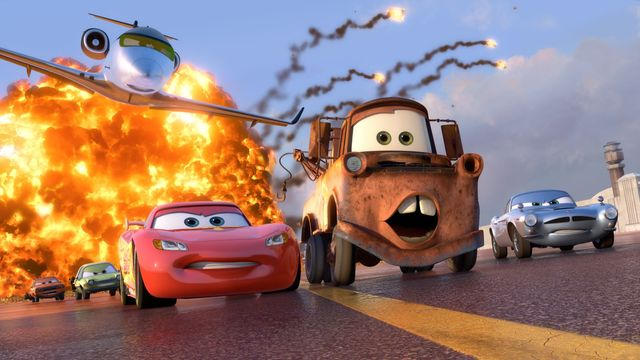 Lightning McQueen and Mater race away from an explosion in Cars 2