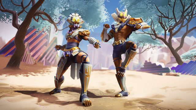 Dauntless - Two armored figures pose in seasonal armor from the Infinite Radiance patch.