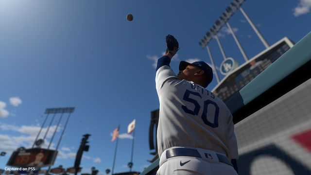 Dodger Mookie Betts jumps at the Dodger Stadium warning track for a fly ball in MLB The Show 21