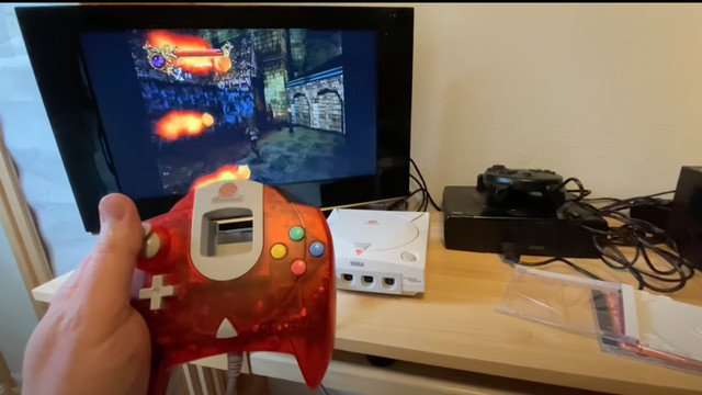 Image taken from YouTube video, a hand holds a Sega Dreamcast controller while a TV shows a stage from the canceled Castlevania: Resurrection
