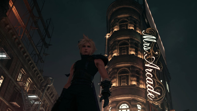 Cloud from Final Fantasy 7 Remake, standing in front of an ornate Beaux-Arts building in Sector 8.