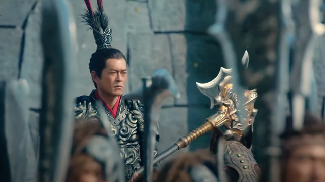 Lu Bu from the Dynasty Warriors movie rides a horse past an army of soldiers