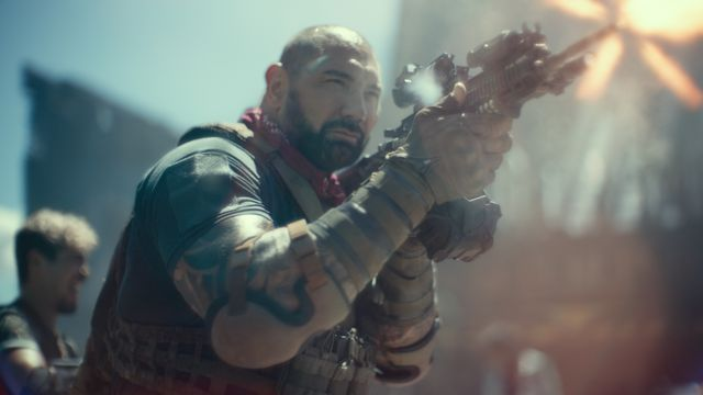 Dave Bautista aiming a giant gun in Zack Snyder's Army of the Dead
