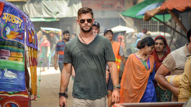 hemsworth, in sunglasses, walks down the street