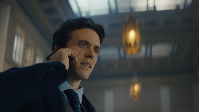 a young robert langdon on the phone