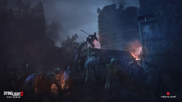 A survivor fends off zombies on top of an ambulance in Dying Light 2 Stay Human