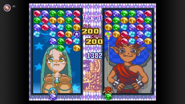 two little fairy characters in the background of a color matching puzzle game