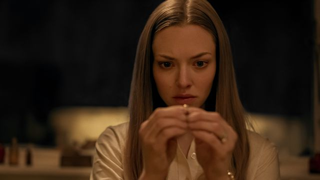 Amanda Seyfried examines a ring she found in Things Heard & Seen