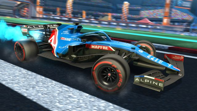 A Rocket League car fitted in the Alpine F1 racing livery, driving on Pirelli soft tyres