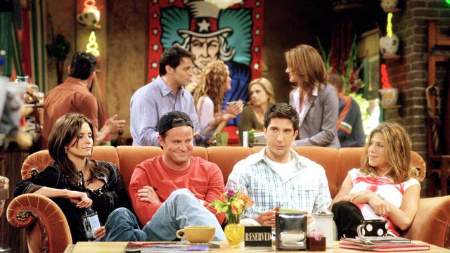 Monica, Chandler, Ross, and Rachel sitting on a couch on Friends