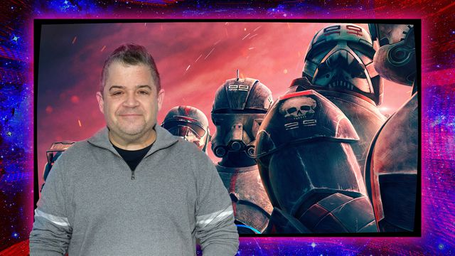 """Photo of actor Patton Oswalt standing in front of Star Wars stormtroopers from animated series """"The Bad Bunch"""""""