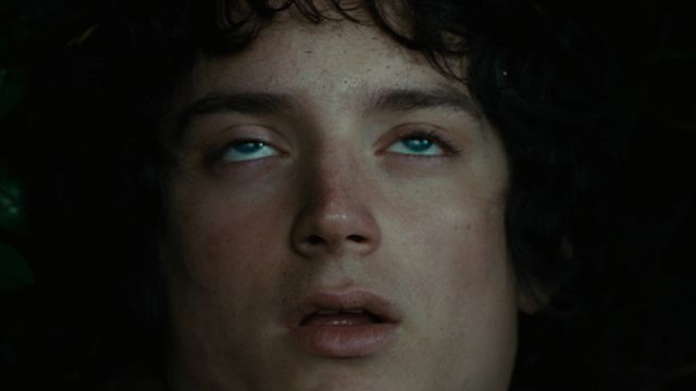 Frodo's mouth falls open slackly as his eyes roll back in The Fellowship of the Ring.