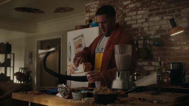 eddie brock making breakfast with the symbiote