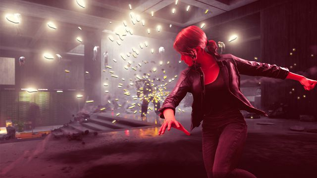 Control protagonist Jesse stands in front of a burst of sparks