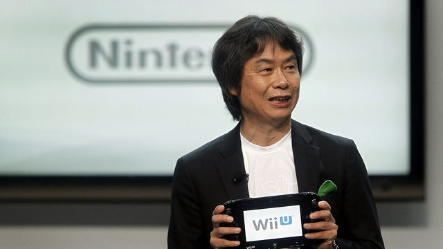 Shigeru Miyamoto speaks at the E3 Expo in Los Angeles in 2012, holding a Wii U GamePad