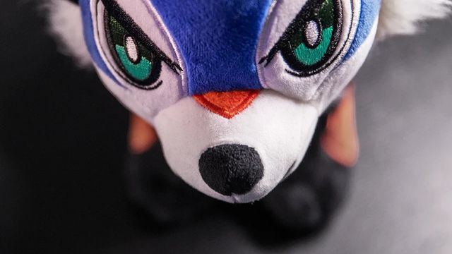 product shot of the officially licensed SonicFox plushie, a blue fox resembling the fighting games champion's unique onstage costume