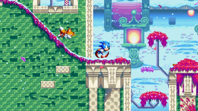 Sonic Mania - Sonic and Tails rush down a pastel colored level with green bricks and cherry blossom trees.