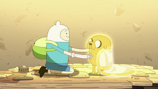 finn embracing jake, who has a gold cloak draped over his shoulders
