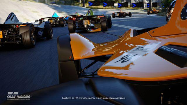 an orange open-wheel racecar partakes in a race in Gran Turismo 7