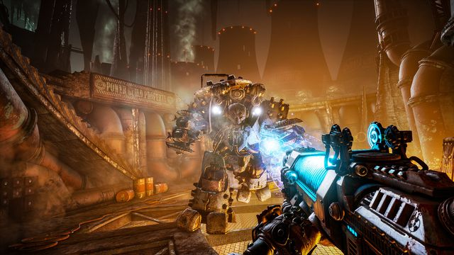 The player character takes aim at a huge mech in Necromunda: Hired Gun