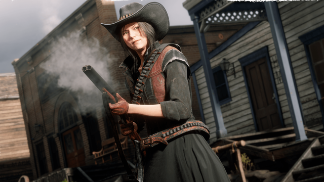 Red Dead Online - a young woman clutches a smoking shotgun. She's dressed in red and black, with a cowboy hat and skirts on, and has black hair. She looks determined.