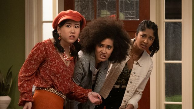 Eleanor, Fabiola, and Devi look skeptically at something ahead in Never Have I Ever season 2.