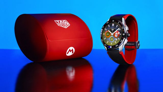 An image of a watch with red band and watch case. it's a really nice Mario watch!