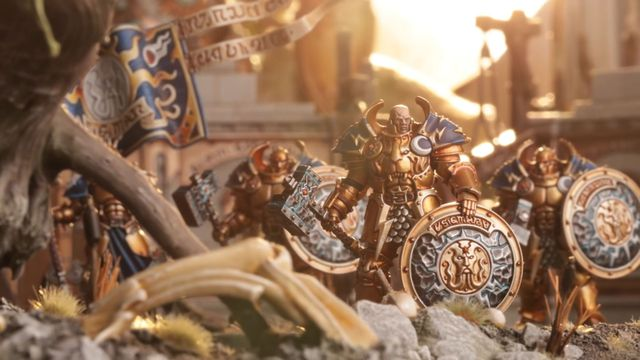 A warrior of the Stormcast Eternals backed by a sun flare.