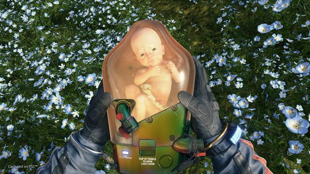 Sam holds BB in a screenshot from Death Stranding