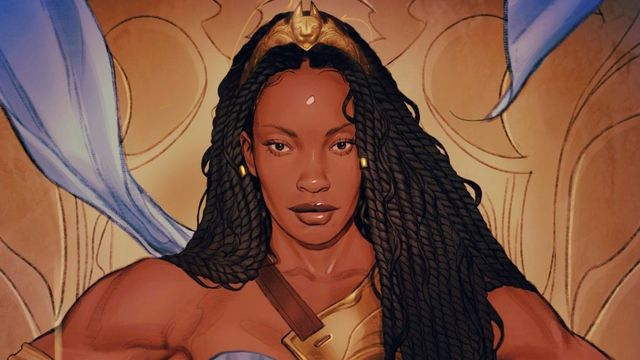 Queen Nubia of the Amazons in her blue and gold regalia, with waist-length locs and a golden circlet, on a variant cover for Nuba and the Amazons (2021).