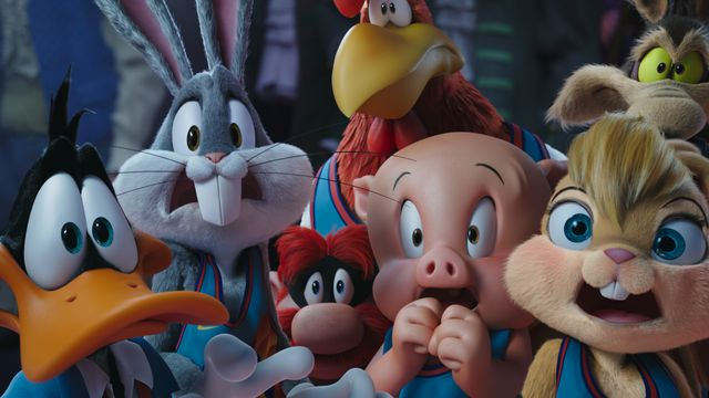 Bugs Bunny, Daffy Duck, and other toon characters of Space Jam: A New Legacy look horrified in a crowded reaction shot