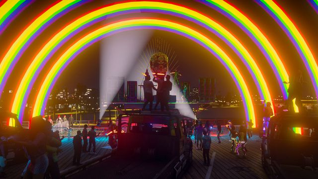 Grand Theft Auto Online - characters on a roleplay server pose under a giant modded rainbow banner at a brightly lit dance party