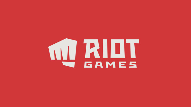 Riot Games logo with punching hand on a red background