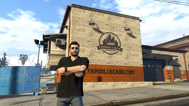 Grand Theft Auto Online - a player's character, Tony Moretti, stands outside his cab company's building on a GTA Online role-play server.
