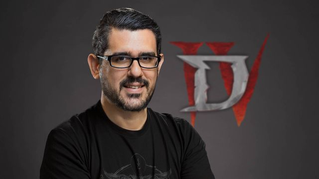 A photo of former Diablo 4 game director Luis Barriga in front of the game's logo