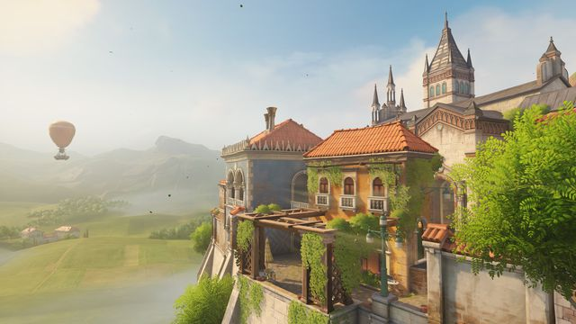Overwatch - a shot of the Malevento map, which shows a charming Italian estate. In the distance is a hot air balloon.