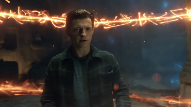 Peter Parker stands in the middle of swirling magic energy looking worried in Spider-Man: No Way Home.