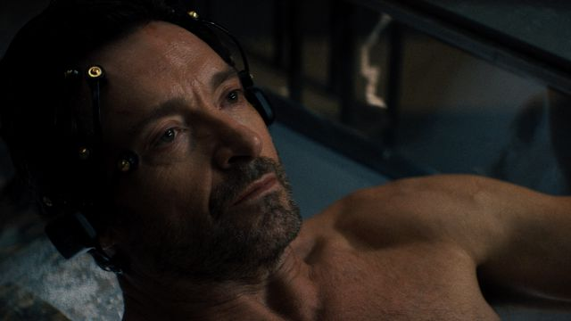Hugh Jackman lies in a tank with electrodes on his head in the science fiction movie Reminiscence