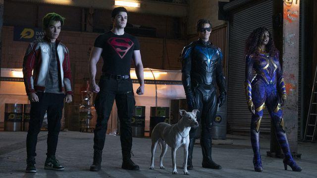 Ryan Potter, Joshua Orpin, Brenton Thwaites, Anna Diop stand in superhero-group lineup pose as Gar Logan, Superboy, Robin, and Starfire