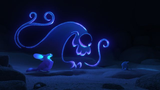 a swirling blue figure in a cave