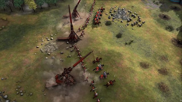 A castle siege featuring multiple trebuchet and foot soldiers from Age of Empires 4
