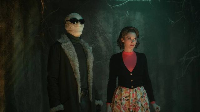 Matt Bomer and April Bowlby stand together in the dark in season 3 of Doom Patrol