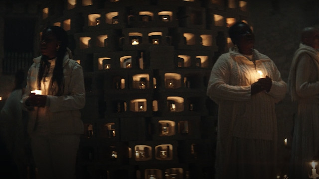 """Women in choir robes, holding candles in the dark, sing Radiohead's """"Karma Police"""" in a sequence from Y: The Last Man."""